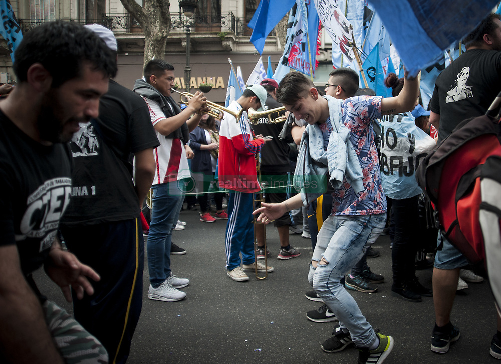 August 7, 2017 - Buenos Aires, Argentina - Social and political organizations march in protest during the religious festival of San Cayetano. The organizations claim the government ''the immediate sanction of the Food Emergency Law'' in Buenos Aires, Argentina, August 7, 2017. (Credit Image: © Gabriel Sotelo/NurPhoto via ZUMA Press)