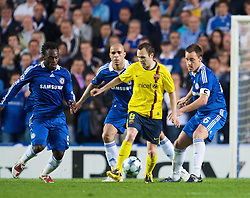 LONDON, ENGLAND - Wednesday, May 6, 2009: Chelsea's players Michael Essien, Alex and John Terry surround Barcelona's Andres Iniesta during the UEFA Champions League Semi-Final 2nd Leg match at Stamford Bridge. (Photo by David Rawcliffe/Propaganda)