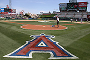 ANAHEIM, CA - MAY 4:  A large A is painted on the grass as the grounds crew prepares the infield for the Los Angeles Angels of Anaheim game against the Texas Rangers at Angel Stadium on Sunday, May 4, 2014 in Anaheim, California. The Rangers won the game 14-3. (Photo by Paul Spinelli/MLB Photos via Getty Images)