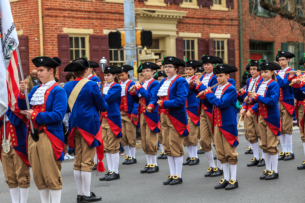York, PA - March 12, 2016: Early American colonial reenactors march in the annual Saint Patrick's Day Parade in the City of York, Pennsylvania.
