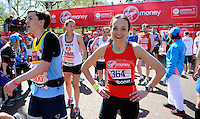 A happy runner after completing the race<br /> The Virgin Money London Marathon 2014<br /> 13 April 2014<br /> Photo: Javier Garcia/Virgin Money London Marathon<br /> media@london-marathon.co.uk