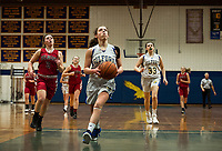 Gilford's Brooke Beaudet takes the ball full court to the basket during NHIAA division III basketball against Belmont Friday evening.  (Karen Bobotas/for the Laconia Daily Sun)