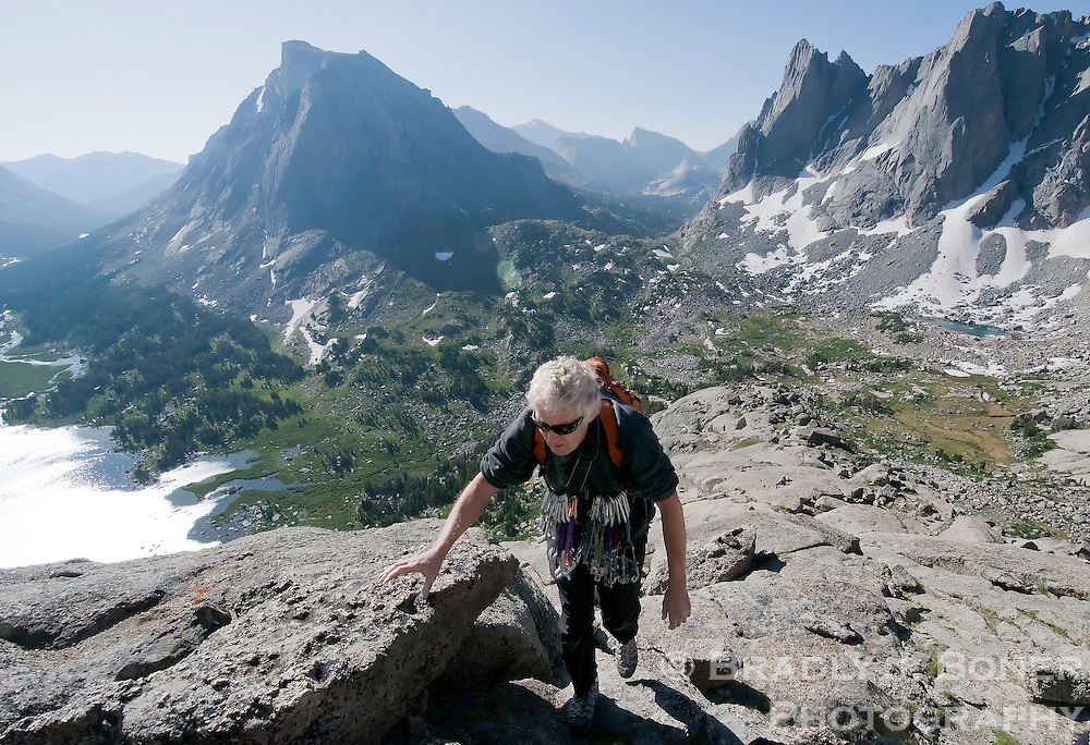 Joe Kelsey, 70, climbs the south shoulder of Pingora Peak in the Cirque of the Towers area of the Wind River Mountains. Kelsey is the author of the iconic climbing guide, Climbing and Hiking in the Wind River Mountains.