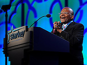 "Gala honoree Archbishop Desmond Tutu speaks at the Starkey Hearing Foundation's ""So the World May Hear"" Awards Gala on Sunday, July 20, 2014 in St. Paul, Minn. The foundation gives away more than 100,000 hearing aids in the U.S. and around the world annually. (Photo by Diane Bondareff/Invision for Starkey Hearing Foundation/AP Images)"