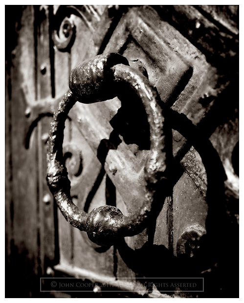 Black and white photograph of door handle at the Barony Church in Glasgow. Mounted print available to purchase.