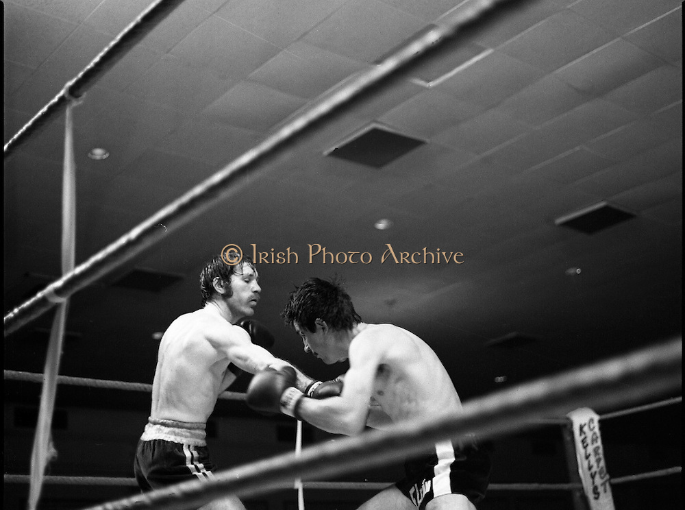Nash vs Leon Championship Fight.    (N55)..1980..14.12.1980..12.14.1980..14th December 1980..At the Burlington Hotel, Dublin, Charlie Nash defended his European Lightweight Title when he took on Spain's Francesco Leon. .Nash is pictured pushing out a straight right as he tries to keep Leon at bay.