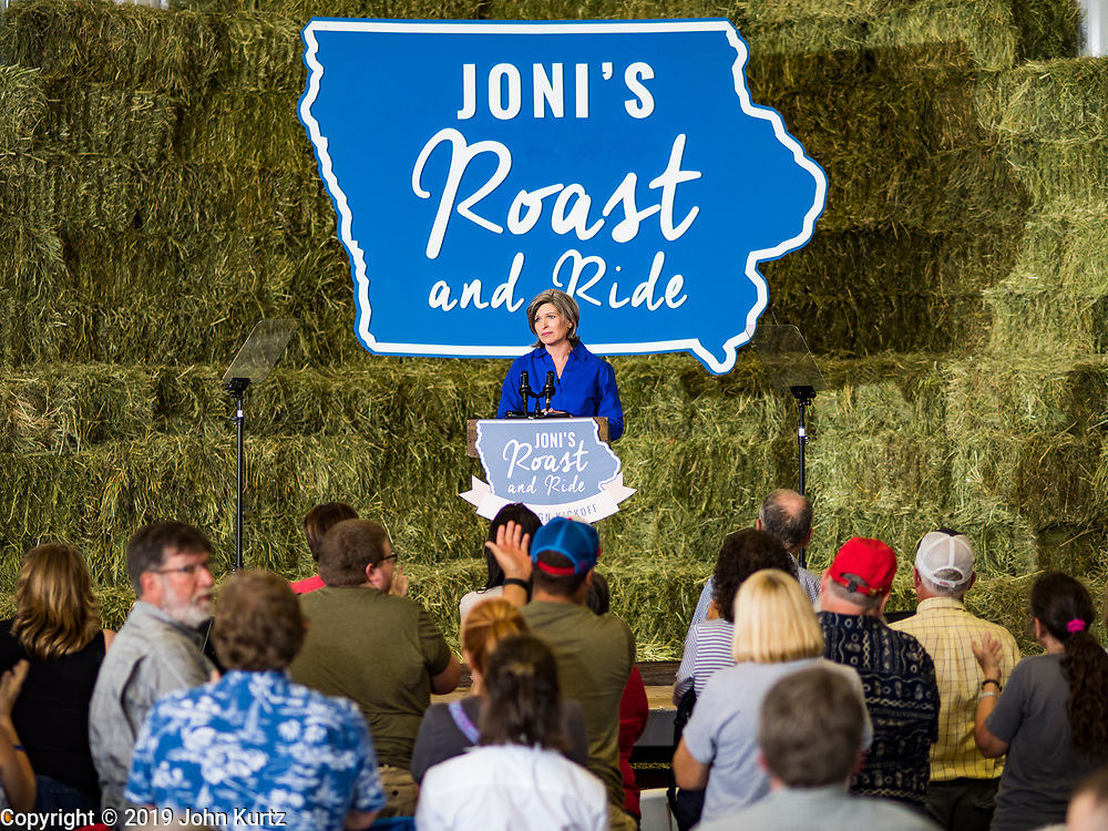 """15 JUNE 2019 - BOONE, IOWA: US Senator JONI ERNST (R-IA) speaks at """"Joni's Roast and Ride,"""" an annual motorcycle ride / barbecue fund raiser hosted by Ernst. Ernst, Iowa's junior US Senator, kicked off her re-election campaign during the """"Roast and Ride"""", an annual fund raiser and campaign event has she held since originally being elected to the US Senate in 2014.  PHOTO BY JACK KURTZ"""