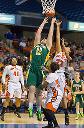 Greenbrier East center Sydney Nunley (50) and South Charleston center Rhea Smith (22) go for a rebound during a first round game at the Charleston Civic Center.