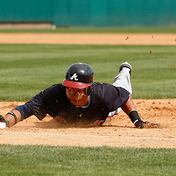 March 4, 2011; Viera, FL, USA; Atlanta Braves second baseman Martin Prado (14) drives back to first base on a pick off attempt during a spring training exhibition game against the Washington Nationals at Space Coast Stadium.  Mandatory Credit: Derick E. Hingle