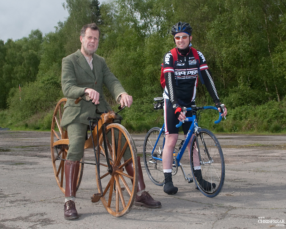 Old and New. Two cyclists, one riding aan exact recreation of Kirkpatrick Macmillan's first pedal powered  bicycle and the other a modern racing bicycle.