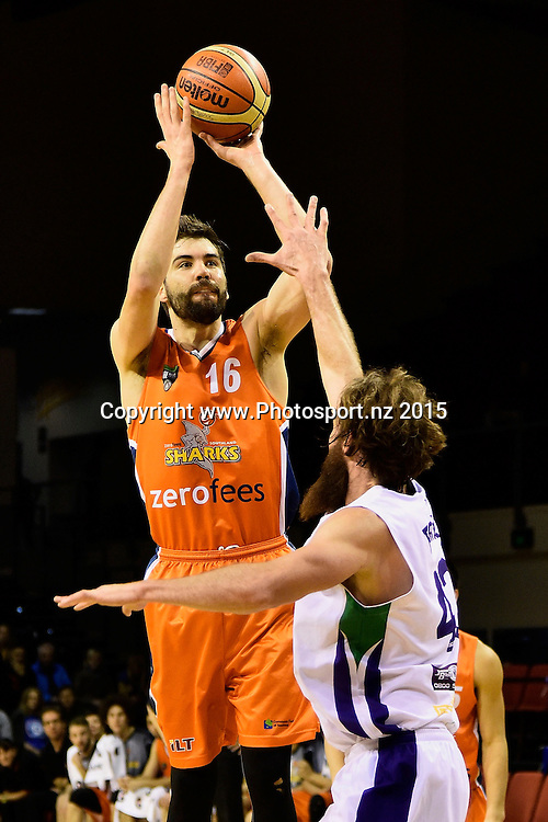 Adrian Majstrovich (L) of the Southland Sharks jumps to shoot with Casey Frank of the Super City Rangers during the NBL semi final basketball match between Southland and Super City Rangers at the TSB Arena in Wellington on Saturday the 4th of July 2015. Copyright photo by Marty Melville / www.Photosport.nz