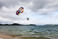 Tourist enjoying parasailing in Nha Trang, Vietnam, Southeast Asia