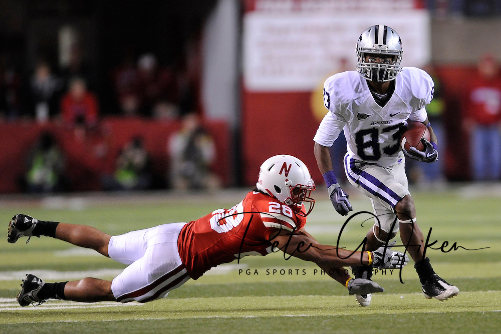 November 21, 2009: Wide receiver Brandon Banks #83 of the Kansas State Wildcats rushes up field after making a catch past safety Eric Hagg #28 of the Nebraska Cornhuskers in the third quarter at Memorial Stadium in Lincoln, Nebraska.