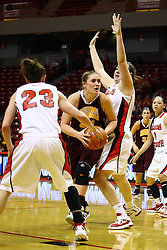 15 March 2012:  Taylor Johnson bumps her way past Marley Hall for a shot at 2 points during a first round WNIT basketball game between the Central Michigan Chippewas and the Illinois Sate Redbirds at Redbird Arena in Normal IL
