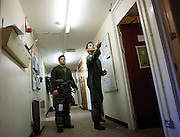 Flt Lt Sam Cowan plays darts with Flt Lt James Portous (L) in the corridor of the QRA crew rooms at RAF Mount Pleasant, Falkland Islands, 16th September 2009.