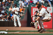 San Francisco Giants third baseman Christian Arroyo (22) fumbles a Los Angeles Dodgers ground ball at third base at AT&T Park in San Francisco, California, on April 27, 2017. (Stan Olszewski/Special to S.F. Examiner)