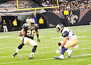 New Orleans Sainst RB Reggie Bush rushes for a first down but no touchdown in the game against the St. Louis Rams. The Saints went on to win 31-13 against the St. Louis Ram.The New Orleans Saints play the St. Louis rams in New Orleans at the Super Dome Sunday Dec. 12,2010. Photo©SuziAltman. Singer and actress MILEY CYRUS poses for a fan's camera phone with New Orleans police officers on the sidelines prior to The New Orleans Saints' kickoff against the St. Louis Rams at the Superdome. Cyrus is currently filming ''So Undercover'' in New Orleans.