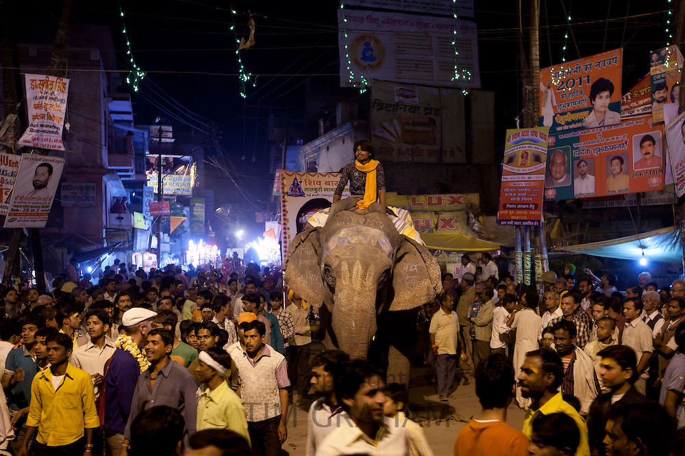 Ceremonial elephant moves through crowd at Festival of Shivaratri in the streets of the holy city of Varanasi, Benares, Northern India