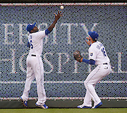Kansas City Royals' center fielder Lorenzo Cain (6) and right fielder Paulo Orlando (16) go after a ball hit by New York Yankees designated hitter Alex Rodriguez in the fourth inning of a baseball game at Kauffman Stadium in Kansas City, Mo., Friday, May. 15, 2015. Rodriguez doubled on the play. (AP Photo/Colin E. Braley)