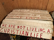 White corrugated plastic sign white- with red lettering- text-we are not living a Christian life-Appx 36 in by 32 in tall<br />