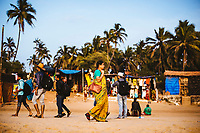 Travelers on Anjuna Beach in northern Goa, India.