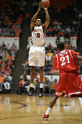 Adrian Joseph (30) shoots a three pointer over a Hartford defender.  Joseph sunk three shots behind the arc and scored 15 points to help the Hoos win 71-62...The Virginia Cavaliers defeated Hartford 71-62 at University Hall in Charlottesville, VA on December 31, 2005.