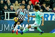 DeAndre Yedlin (#22) of Newcastle United takes on Nathan Ake (#5) of Bournemouth during the Premier League match between Newcastle United and Bournemouth at St. James's Park, Newcastle, England on 10 November 2018.