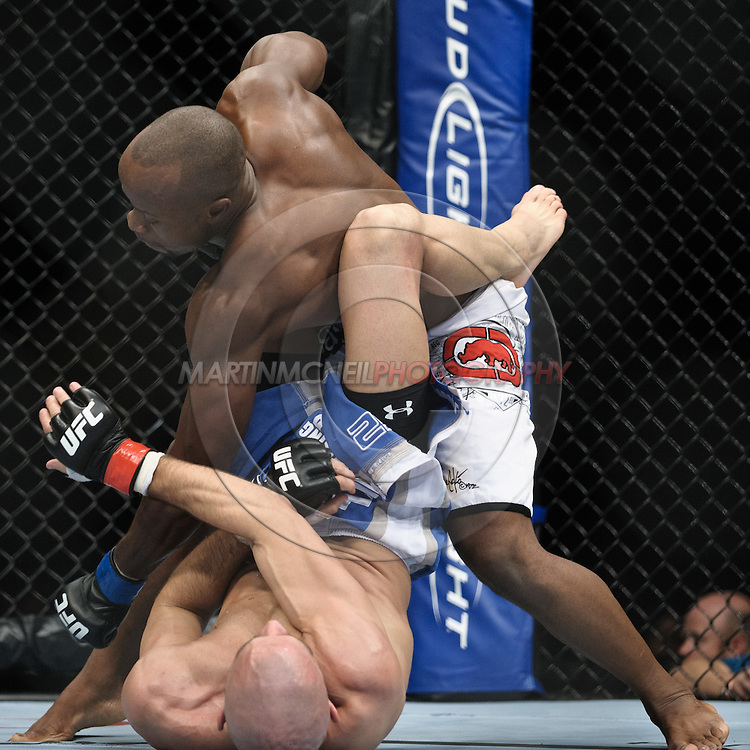 "LONDON, ENGLAND, OCTOBER 2010: Claude Patrick (top) has his punch deflected by James Wilks during ""UFC 120: Bisping vs. Akiyama"" inside the O2 Arena in Greenwich, London"