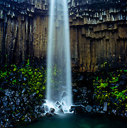 The shape of Svartifoss waterfall, in Skaftafell National Park, almost resembles a beam of light coming from above.