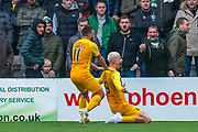 Lyndon Dykes (#9) of Livingston FC and Steven Lawless (#11) of Livingston FC celebrate in front of the Celtic fans after scoring Livingston's second goal during the Ladbrokes Scottish Premiership match between Livingston FC and Celtic FC at The Tony Macaroni Arena, Livingston, Scotland on 6 October 2019.