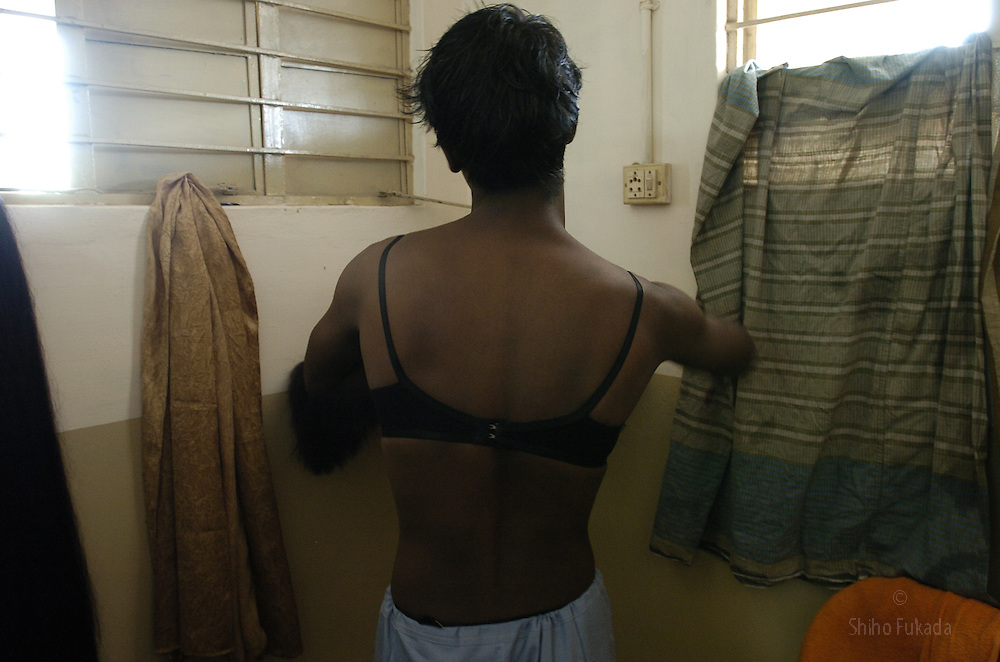 "A transgender puts on her cloth in Villupuram, India. As transgenders,""hijras"" in local terms, are acutely marginalized in Indian society, the major earning avenues for them are sex work, begging and performing at rituals."