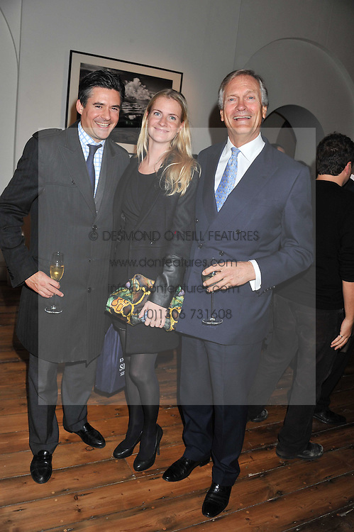 Left to right, EDWARD TAYLOR, CHLOE DELEVINGNE and her father CHARLES DELEVINGNE at a private view of AMAZON an exhibition of photographs in aid of 'Sky Rainforest Rescue' held in the East Wing Galleries, Somerset House, London on 1st November 2011.