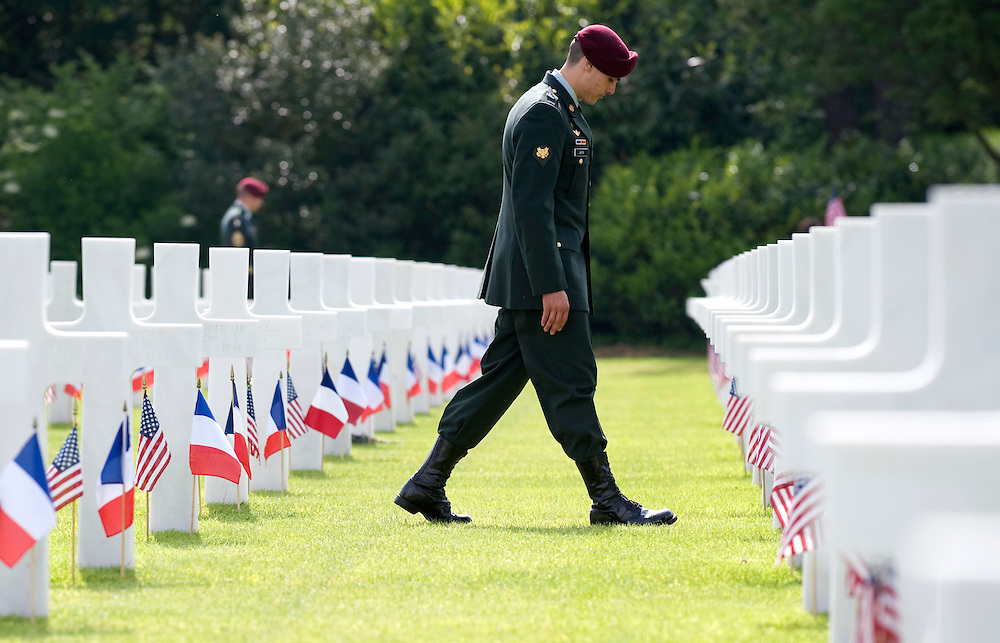 US Army Specialist Ruben Jara of San Diego California walks amongst crosses in the US war cemetery in Colleville-Sur-Mer, Normandy in Northern France, 06 June 2009. US President Barack Obama  will attend an official memorial ceremony   at the cemetery to mark the 65th anniversary of the Allied Normandy beach landings.