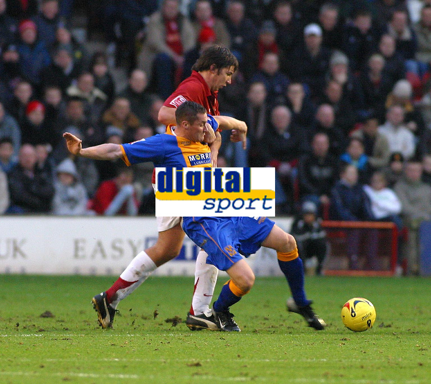 Photo: Dave Linney.<br />Walsall v Shrewsbury Town. Coca Cola League 2. 26/12/2006. Walsall's Ian  Roper(L) keeps a close eye on  Andy Cooke.
