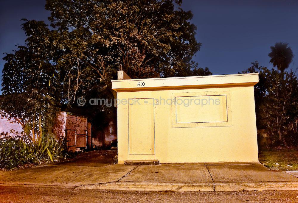 Night photos of buildings in derelict neighborhoods in Florida