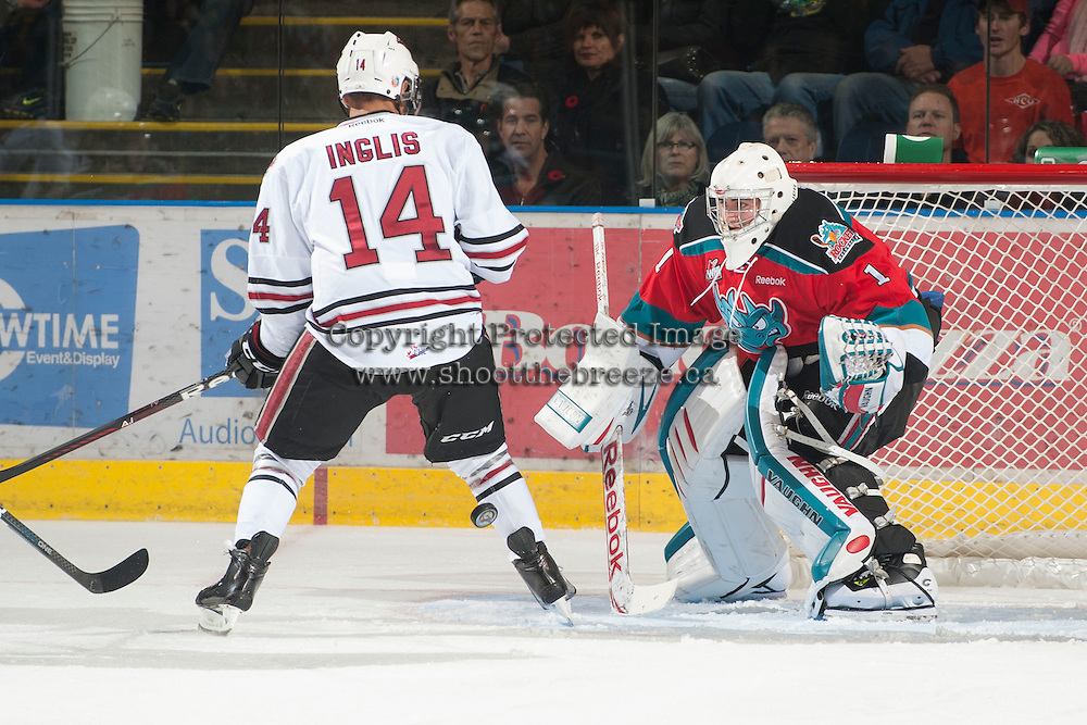 KELOWNA, CANADA - NOVEMBER 9:  Jackson Whistle #1 of the Kelowna Rockets defends the net against Charles Inglis #14 of the  Red Deer Rebels at the Kelowna Rockets on November 9, 2012 at Prospera Place in Kelowna, British Columbia, Canada (Photo by Marissa Baecker/Shoot the Breeze) *** Local Caption ***