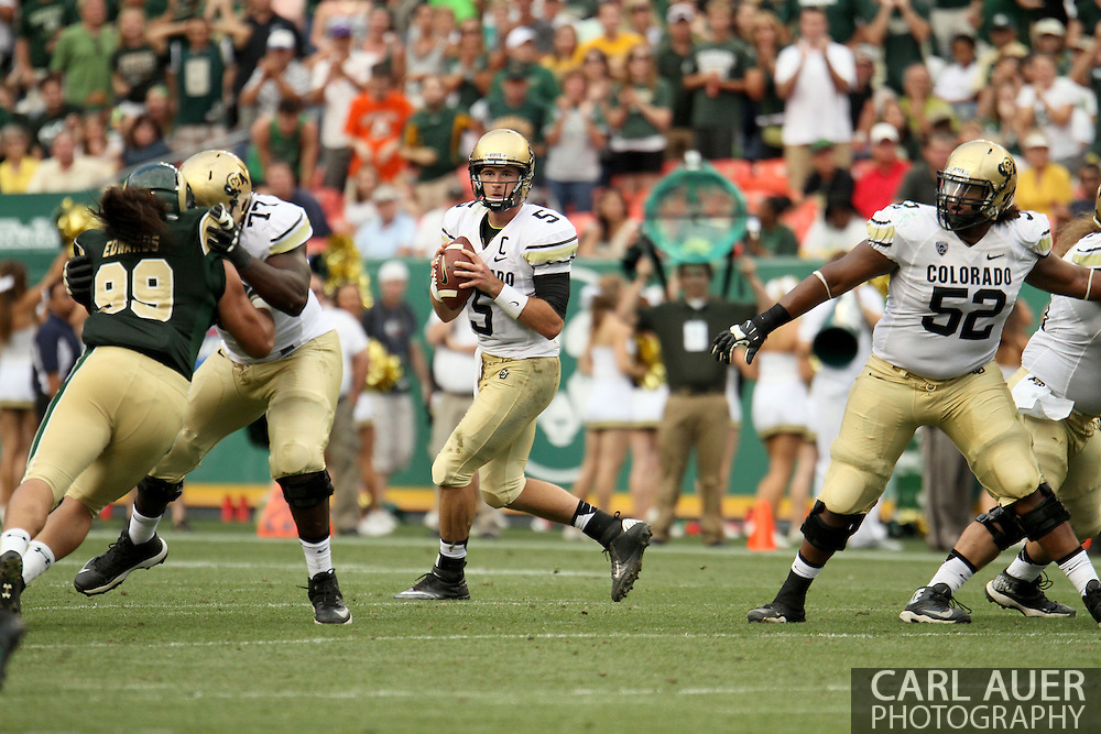 September 1st, 2013 - Colorado Buffaloes junior quarterback Connor Wood (5) looks for a open receiver in the second half of the NCAA football game between the Colorado Buffaloes and the Colorado State Rams at Sports Authority Field in Denver, CO
