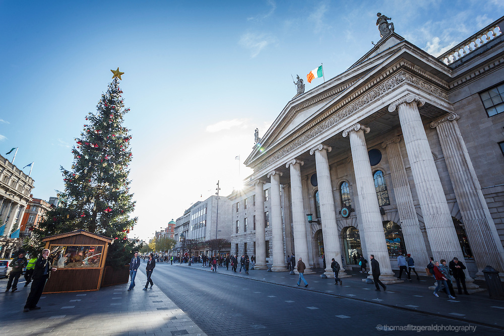 2012: Dublin, Ireland. A wide angle view of O'Connell Street showing the christmas Tree and the Landmark GPO building
