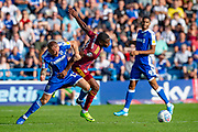 Gillingham FC defender Barry Fuller (12) and Ipswich Town defender Kane Vincent-Young (24) during the EFL Sky Bet League 1 match between Gillingham and Ipswich Town at the MEMS Priestfield Stadium, Gillingham, England on 21 September 2019.