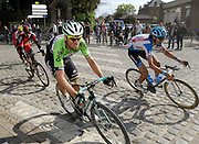 France April 13th 2014: Images from Paris Roubaix cycle race. Riders and race vehicles pass through Gruson on the way to the finish in Roubaix Velodrome. Copyright 2014 Peter Horrell