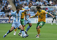 Coventry - Saturday August 9th, 2008: Daniel Fox of Coventry City and Jamie Cureton of Norwich City during the Coca Cola Championship match at The Ricoh Arena, Coventry. (Pic by Michael Sedgwick/Focus Images)