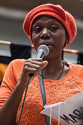 London, UK. 29 July, 2019. A woman takes part in an interactive performance for activists from Reclaim the Power, All African Women's Group, Docs Not Cops, Lesbians and Gays Support the Migrants and other groups taking part in a demonstration outside the Home Office to demand an end to the Government's 'hostile environment' policies.