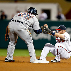 Mar 7, 2013; Lake Buena Vista, FL, USA; Atlanta Braves shortstop Tyler Pastornicky (1) is helped up from the ground after colliding on a force out at second base with Detroit Tigers first baseman Prince Fielder (28) during the top of the fourth inning of a spring training game at Champion Stadium. Mandatory Credit: Derick E. Hingle-USA TODAY Sports