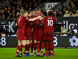WOLVERHAMPTON, ENGLAND - Friday, December 21, 2018: Liverpool's Virgil van Dijk (hidden) celebrates scoring the second goal with team-mates during the FA Premier League match between Wolverhampton Wanderers FC and Liverpool FC at Molineux Stadium. Liverpool won 2-0. (Pic by David Rawcliffe/Propaganda)