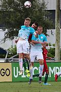 Slovenia forward Matjaz Kamensek (15) midfielder Gasper Cerne (5) and Portugal midfielder Marco Cruz (10) go up for a header during a CONCACAF boys under-15 championship soccer game, Sunday, August 11, 2019, in Bradenton, Fla. Portugal defeated Slovenia in the final in 2-0. (Kim Hukari/Image of Sport)
