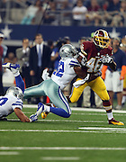 Washington Redskins running back Alfred Morris (46) gets tackled by Dallas Cowboys free safety Barry Church (42) as he runs the ball inside the Dallas Cowboys 10 yard line in the first quarter during the NFL week 6 football game against the Dallas Cowboys on Sunday, Oct. 13, 2013 in Arlington, Texas. The Cowboys won the game 31-16. ©Paul Anthony Spinelli