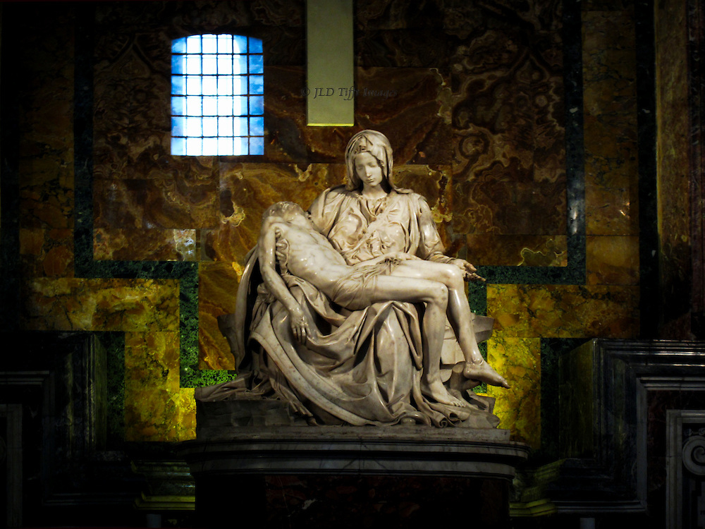 St. Peter's Basilica: Michelangelo's Pieta, through the protective glass now in front of it.  Window opposite is reflected in the glass.