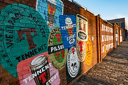 Mural featuring Tennent's beer mat designs on wall at Tennent Caledonian Breweries  Wellpark Brewery in Glasgow, Scotland, UK