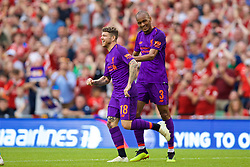DUBLIN, REPUBLIC OF IRELAND - Saturday, August 4, 2018: Liverpool's Alberto Moreno celebrates scoring the fifth goal with team-mate Fabio Henrique Tavares 'Fabinho' during the preseason friendly match between SSC Napoli and Liverpool FC at Landsdowne Road. (Pic by David Rawcliffe/Propaganda)