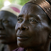 Nannies gathered together during the Kenya Learning Tours visit  to Strenthening the House of Nanny project. This project supports 3,191 orphans and 1,027 orphans. The nannies are all over 45 years old and live with a minimum of two orphans whose parents died of HIV. The project helps the elderly nannies finance small income generating programs.